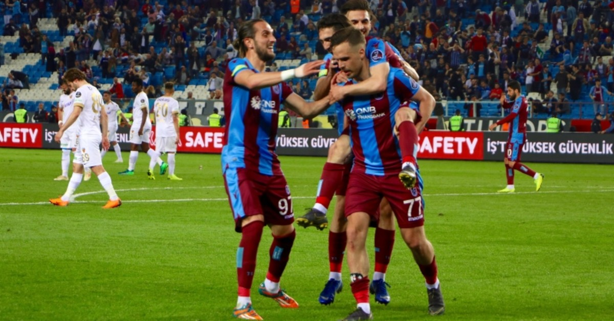 Trabzonspor's Filip Novak celebrates the team's fourth goal with his teammates in 31th week match against Kayserispor at u015eenol Gu00fcneu015f Stadium, in Trabzon, northern Turkey, May 6, 2018. (AA Photo)