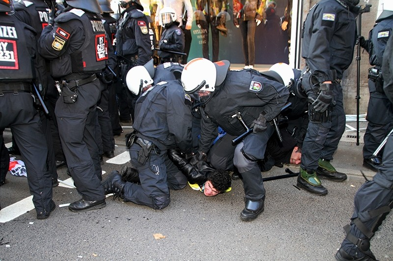 German police detains pro-PKK supporter during terrorist group's rally in Germany's Dusseldorf, Nov. 4, 2017 (AA Photo)