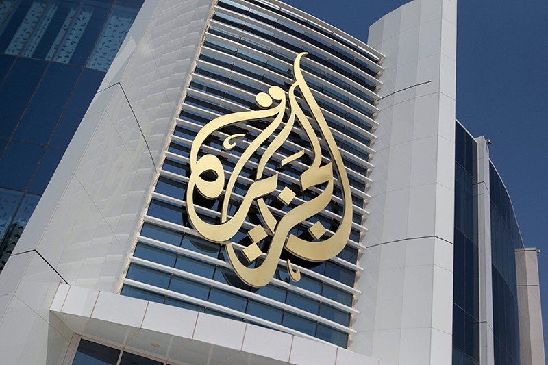 The logo of Al Jazeera Media Network is seen on its headquarters building in Doha, Qatar June 8, 2017 (Reuters Photo)