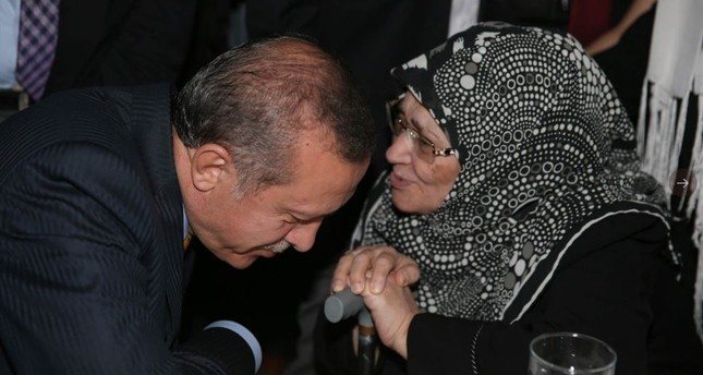President Recep Tayyip Erdoğan listens to Şule Yüksel Şenler in this undated photo. The president described Şenler as a pioneer and a valuable writer who devoted her life to raising consciousness among the youth.