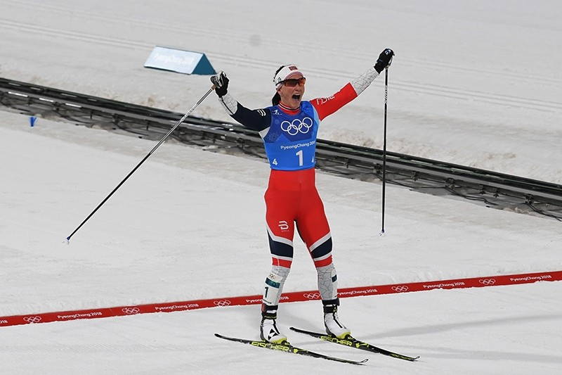 Norway's Marit Bjorgen celebrates winning the women's 4x5km classic free style cross country relay at the Alpensia cross country ski center during the Pyeongchang 2018 Winter Olympic Games in Pyeongchang, South Korea, Feb. 17, 2018. (AFP Photo)