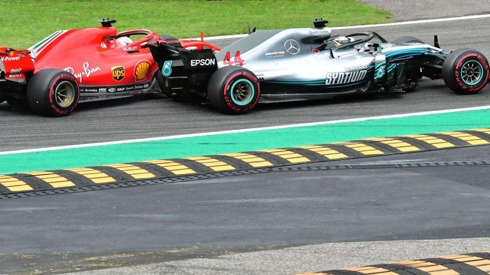 Mercedesu2019 British driver Lewis Hamilton (front) and Ferrariu2019s German driver Sebastian Vettel crash during the Italian Formula One Grand Prix at the Autodromo Nazionale circuit in Monza, Sept. 2.