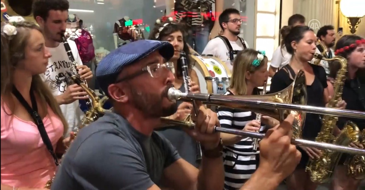 Screengrab from video shows Poil Ou2019Brass Band performing in Istanbul's Taksim Square, Aug. 8, 2019. (AA)