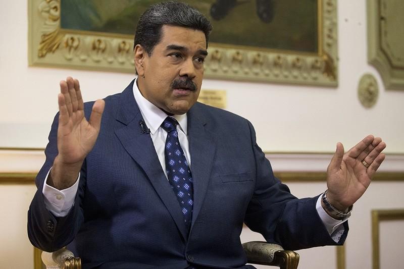 Venezuela's President Nicolas Maduro speaks during an interview with The Associated Press at Miraflores presidential palace in Caracas, Venezuela, Thursday, Feb. 14, 2019. (AP Photo)