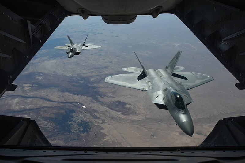 A handout photo made available by the U.S. Department of Defense shows two US Air Force F-22 Raptors flying above Syria in support of Operation Inherent Resolve, Feb. 2, 2018. (EPA Photo)