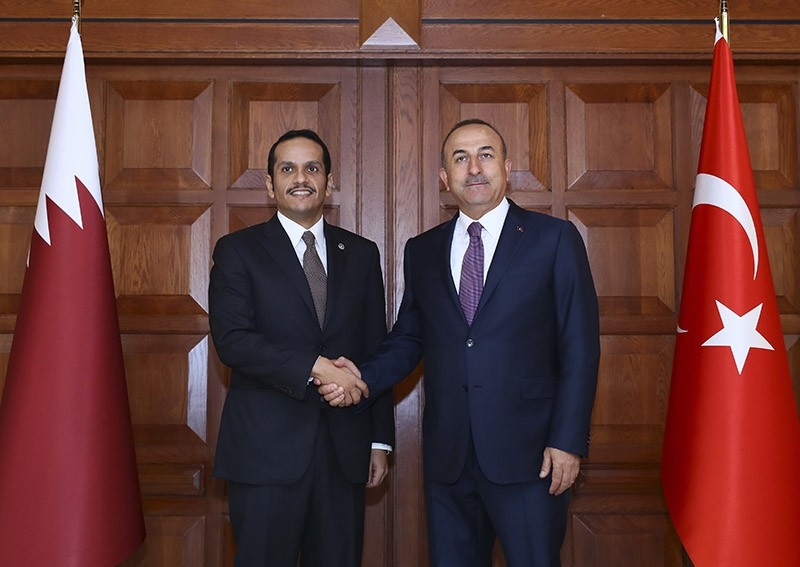 Foreign Minister Mevlu00fct u00c7avuu015fou011flu, right, shakes hands with Qatar's Foreign Minister Sheikh Mohammed bin Abdulrahman Al Thani, left, prior to their meeting in Ankara, Friday July 14, 2017. (AP Photo)
