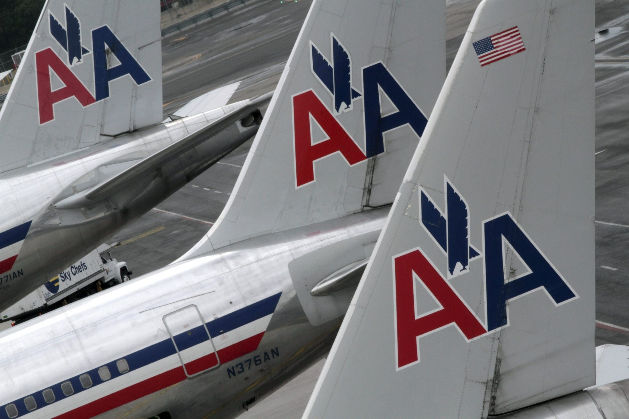 In this Wednesday, Aug. 1 2012 file photo, American Airlines airplanes are parked at their gates at JFK International airport in New York. (AP Photo)