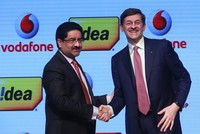 British mobile phone giant Vodafone's Indian unit will merge with Idea Cellular to create India's largest telecoms operator, the firms said yesterday, as they combine to fight the rise of Reliance...