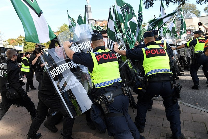 Police officers stop NMR demonstrators from trying to walk along a forbidden street during the Nordic Resistance Movement (NMR) march in central Gothenburg, Sweden September 30, 2017. (Reuters Photo)
