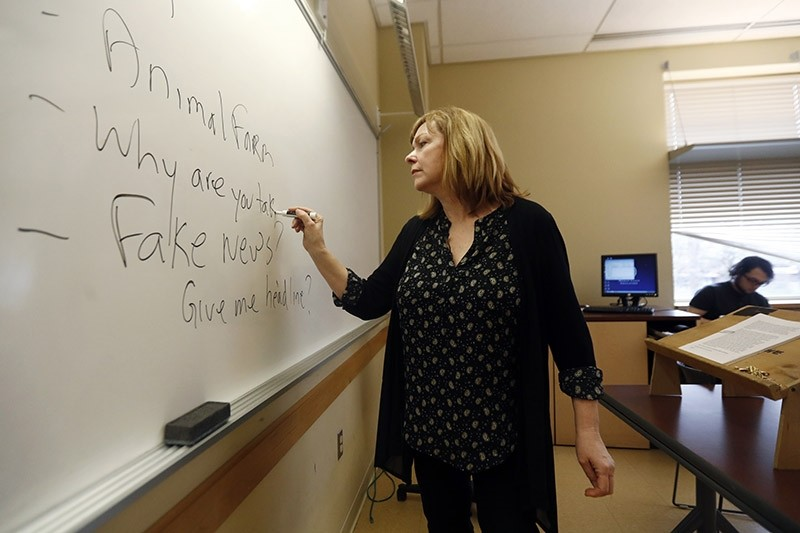 In this Friday, Jan. 20, 2017, photo, Pat Winters Lauro, a journalism professor at Kean University in Union, N.J., leads a class discussion talking about fake news (AP Photo)