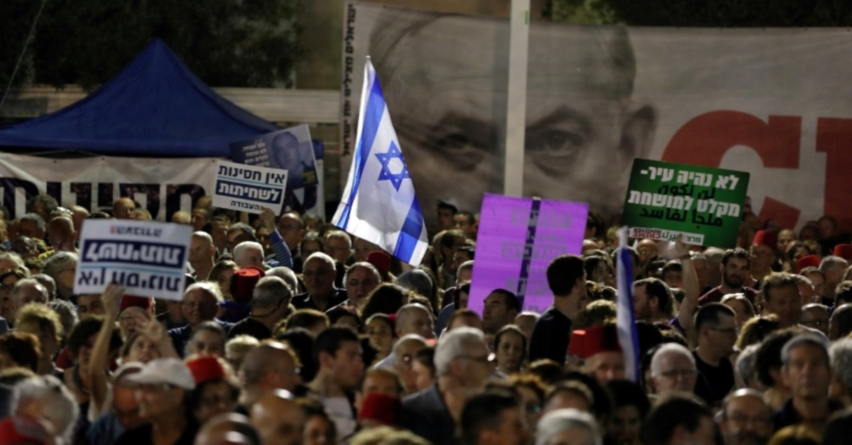 Tens of thousands of Israelis hold a demonstration in Tel Aviv against Netanyahu who seeks immunity from corruption charges. (Reuters Photo)