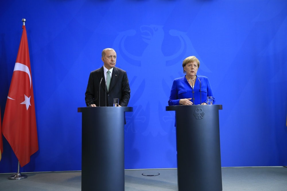 President Erdou011fan (L) and German Chancellor Angela Merkel during a press conference in Berlin, Sept. 28.