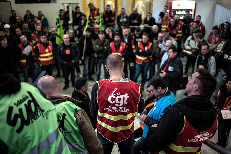 SNCF (French National Railway Corporation) employees look on during a trade union general meeting at the Lyon Perrache railway station on April 3, 2018 in Lyon (AFP Photo)
