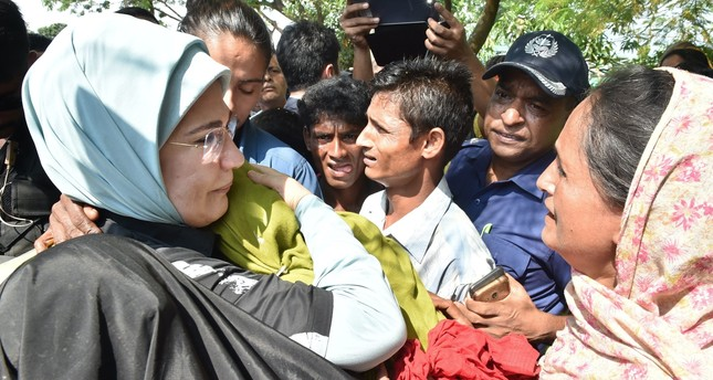 First lady Emine Erdoğan (L) hugs a Rohingya refugee who fled from the Myanmar government's brutality at a makeshift camp near Cox's Bazar, Bangladesh, September 2017.