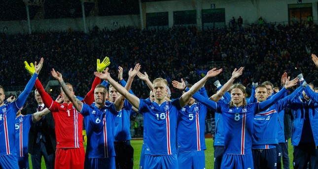 Iceland players do the 'Huh' with supporters after the FIFA World Cup 2018 qualification match between Iceland and Kosovo in Reykjavik, Iceland, 09 October 2018. (EPA Photo)