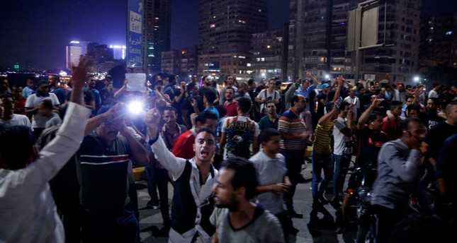 Egyptian protesters shout slogans as they take part in a protest calling for the removal of President Abdel Fattah al-Sisi in Cairo's downtown on Sept. 20, 2019 AFP Photo