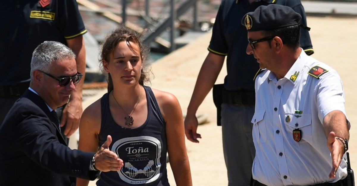 Carola Rackete, the 31-year-old Sea-Watch 3 captain, disembarks from a Finance police boat and is escorted to a car, in Porto Empedocle, Italy July 1, 2019. (REUTERS Photo)