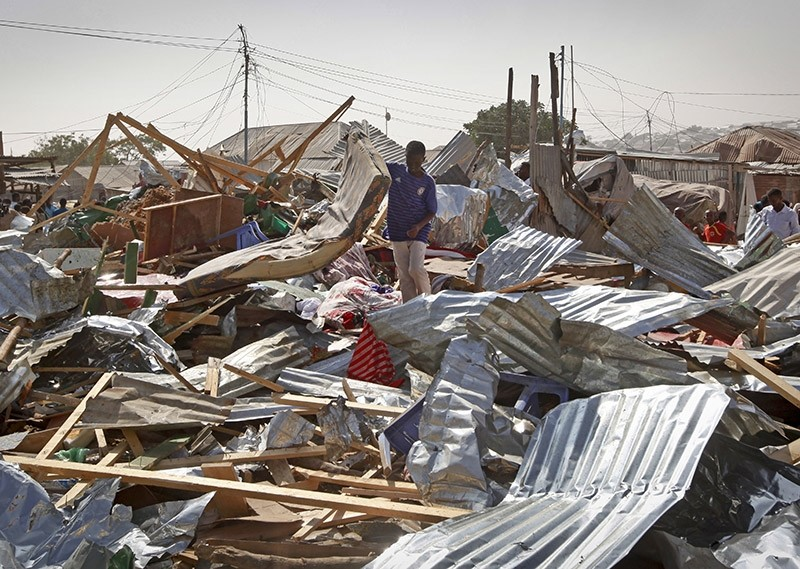 A shopkeeper surveys the wreckage of shops destroyed by a blast in a market in the capital Mogadishu, Somalia Sunday, Feb. 19, 2017. (AP Photo)