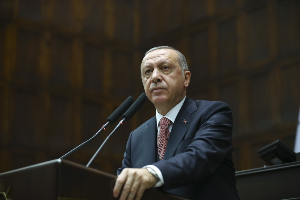 President Recep Tayyip Erdou011fan addresses members of his ruling AK Party during a meeting in Parliament yesterday.