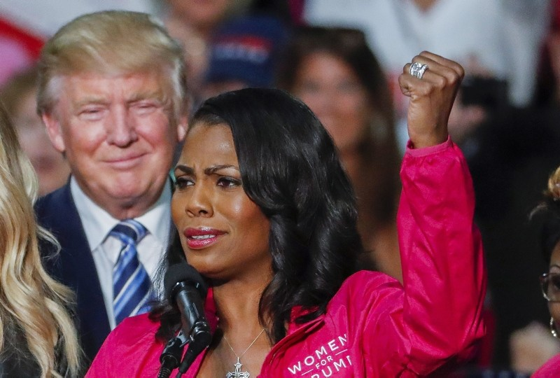 Donald J. Trump (L) participates in a campaign rally with members of the group Women for Trump with Omarosa Manigault (R) in Charlotte, North Carolina, USA, 14 October 2016 (reissued 10 August 2018). (EPA Photo)