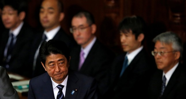 Japanese Prime Minister Abe leaves after the lower house defeated a no-confidence motion against his cabinet, which was submitted by four opposition parties at parliament in Tokyo, Japan, May 31.