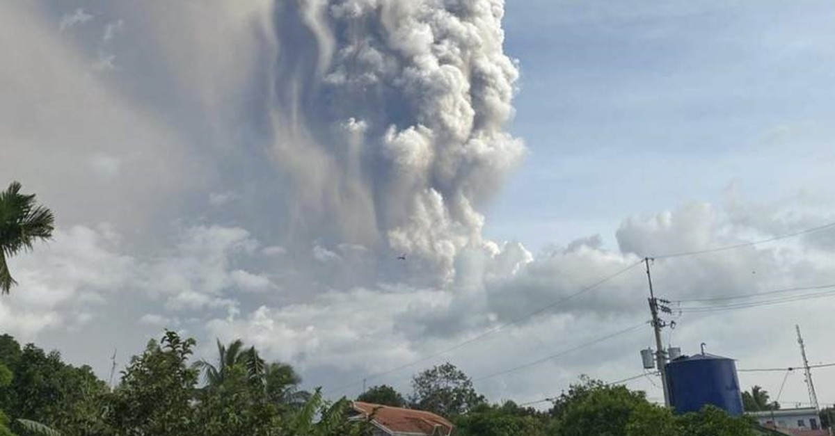 A small volcano near the Philippine capital of Tagaytay that draws tourists for its picturesque setting in a lake erupts with a massive plume of ash and steam Sunday, Jan. 12, 2020. (AP Photo)