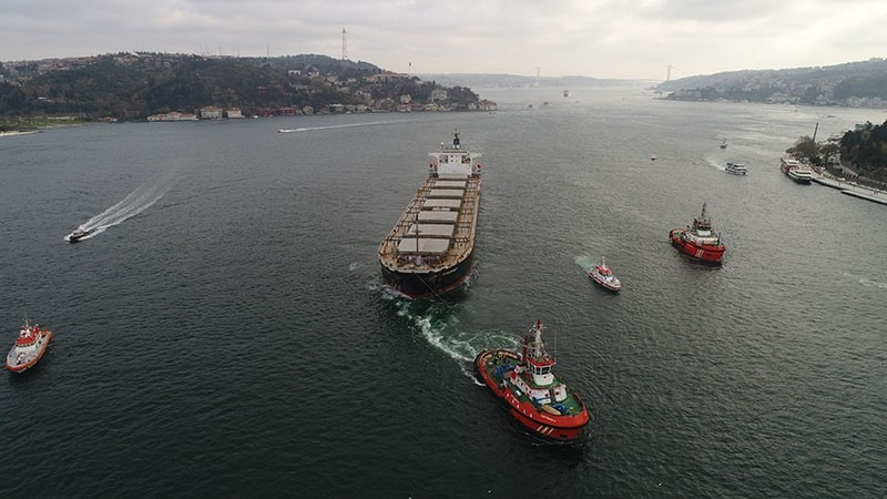 The The Malta-flagged bulk carrier Vitaspirit is being towed to the Marmara Sea in the Bosporus Strait following the crash that caused extensive damage to a waterfront mansion, on April 7, 2018. (IHA Photo)