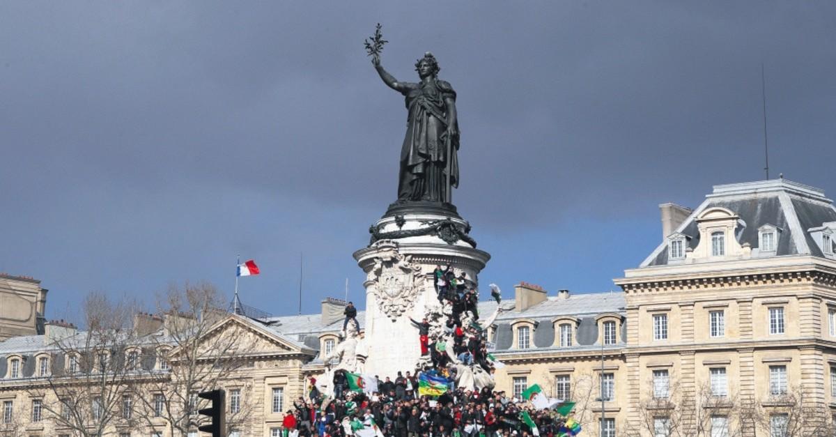 Demonstrators stage a protest to denounce President Abdelaziz Bouteflika's bid for a fifth term at the Place de la Ru00e9publique in Paris, March 10, 2019.