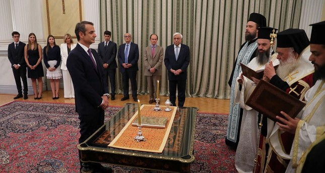 Leader of New Democracy conservative party and winner of Greek general election Kyriakos Mitsotakis is sworn in as prime minister during a ceremony at the Presidential Palace in Athens, Greece July 8, 2019. (Reuters Photo)