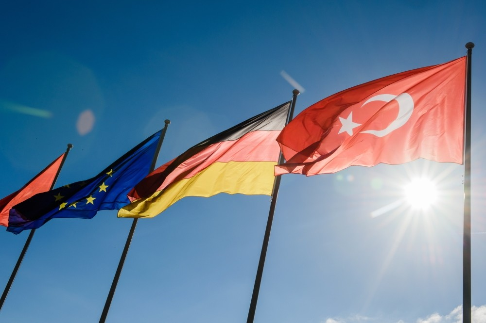 From left to right, the flags of the EU, Germany and Turkey wave prior to the arrival of President Erdou011fan at Berlin Tegel Airport for an official visit to Berlin, Sept. 27.