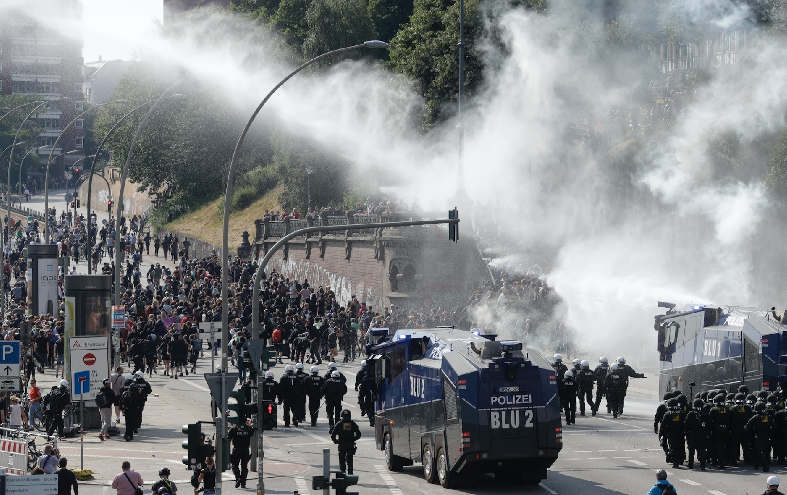 German police use a water cannon to clear a road on the first day of the G20 Summit in Hamburg, July 7, when a group of activists gathered to protest the G20 organization.