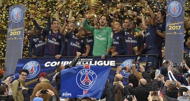 Paris Saint Germain players celebrate their win with the trophy after the the French Coupe de la Ligue final soccer match. EPA Photo