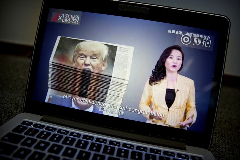 An online video about U.S.-China trade tensions produced by China's state television broadcaster plays on a computer screen in Beijing, China, Thursday, Aug. 23, 2018. (AP Photo)