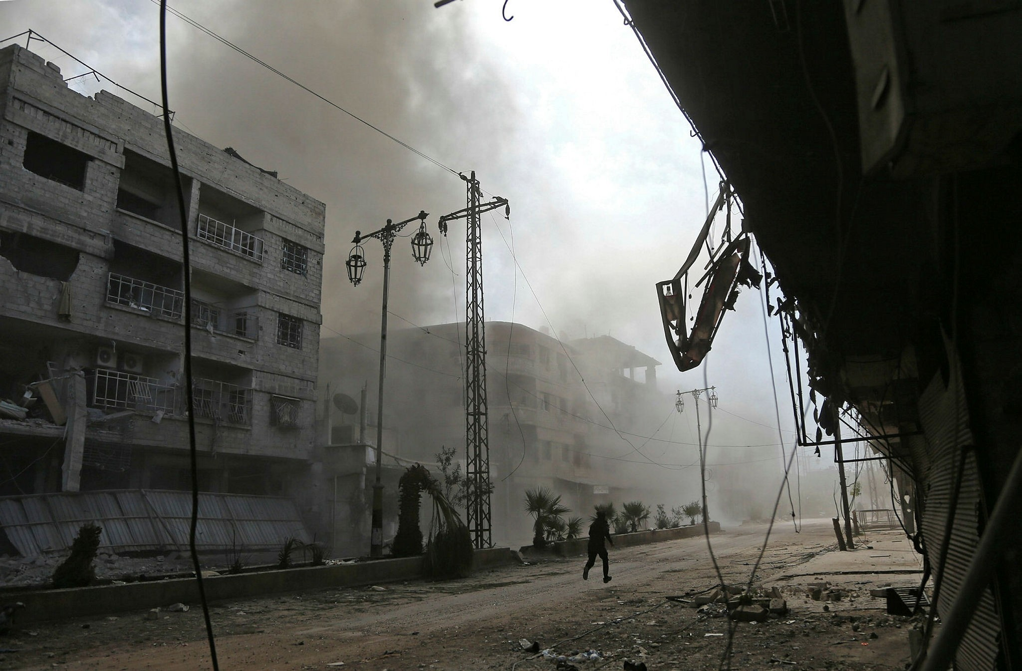Fotoaltu0131: Smoke and dust rise after Syrian regime airstrike in the besieged Eastern Ghouta district, Feb, 21.