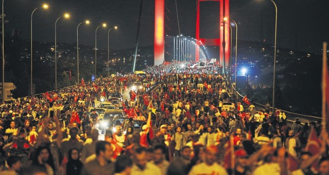 People walk over the Bosporus Bridge, now called the July 15 Martyrs' Bridge, in protest of FETÖ's deadly coup attempt, Istanbul, July 21.