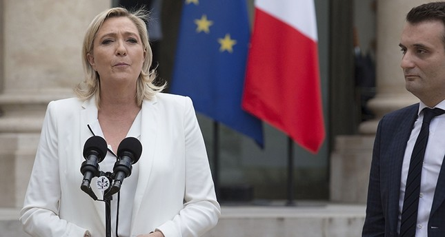 France's Far-right National Front (FN) party leader Marine Le Pen (L) makes a statement, next to FN vice-president Florian Philippot, following a meeting with French President on June 25, 2016 at the Elysee Palace in Paris (AFP Photo)