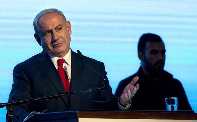 Israeli Prime Minister Benjamin Netanyahu gestures during a rally of his Likud party supporters, near Tel Aviv, Israel, Wednesday, Aug. 30, 2017. (AP Photo)