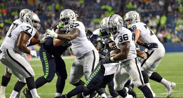 James Butler #36 of the Oakland Raiders scores late in the fourth quarter during the preseason game against the Seattle Seahawks at CenturyLink Field on August 29, 2019 in Seattle, Washington (AFP Photo)