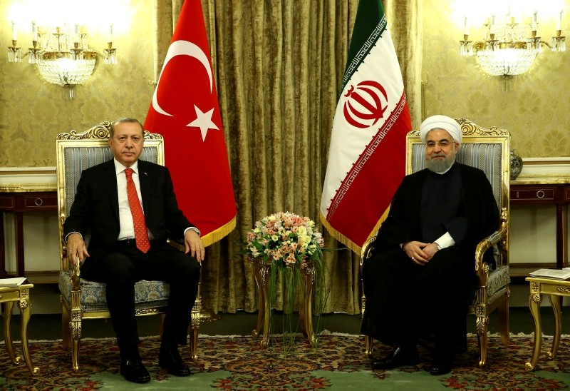 President Recep Tayyip Erdou011fan, left, meets with Iranian President Hassan Rouhani, right, at the Saadabad Palace in Tehran, Iran, Oct. 4, 2017.