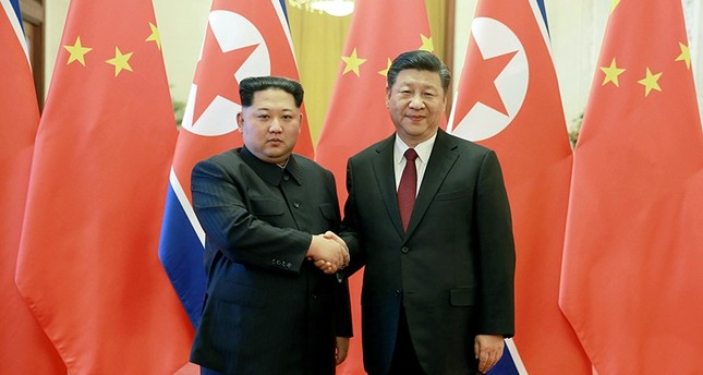 In this March 26, 2018, file photo, North Korean leader Kim Jong Un, left, and Chinese counterpart Xi Jinping, shake hands at the Great Hall of the People in Beijing. (AP Photo)