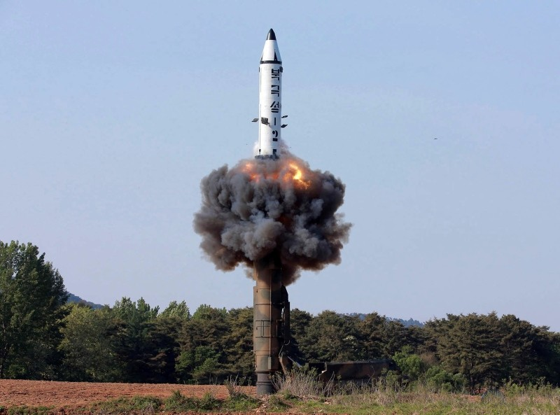 In this undated file photo distributed by the North Korean government on May 22, 2017, a solid-fuel ,Pukguksong-2, missile lifts off during its launch test at an undisclosed location in North Korea. (Korean Central News Agency/ via AP)