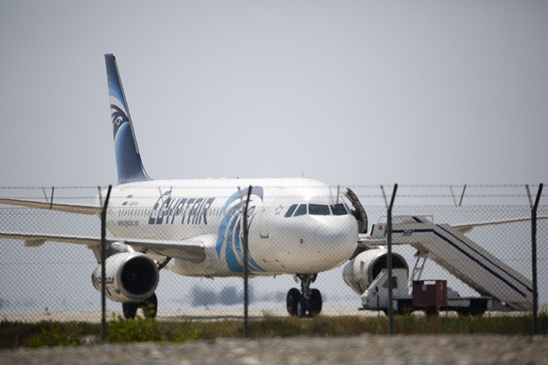 An EgyptAir Airbus A-320 sits on the tarmac of Larnaca airport after it was hijacked and diverted to Greek Cyprus on March 29, 2016. (AFP Photo)