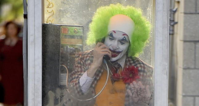 Joaquin Phoenix films Joker in a telephone booth in Brooklyn, New York.