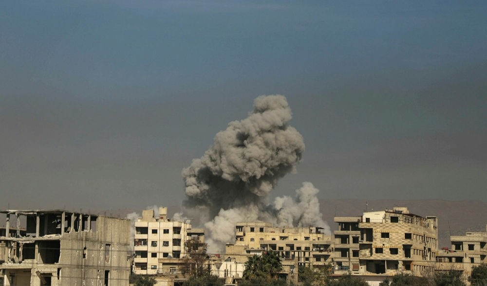 Smoke billows from Hazeh, an opposition enclave in Eastern Ghouta, March 15.