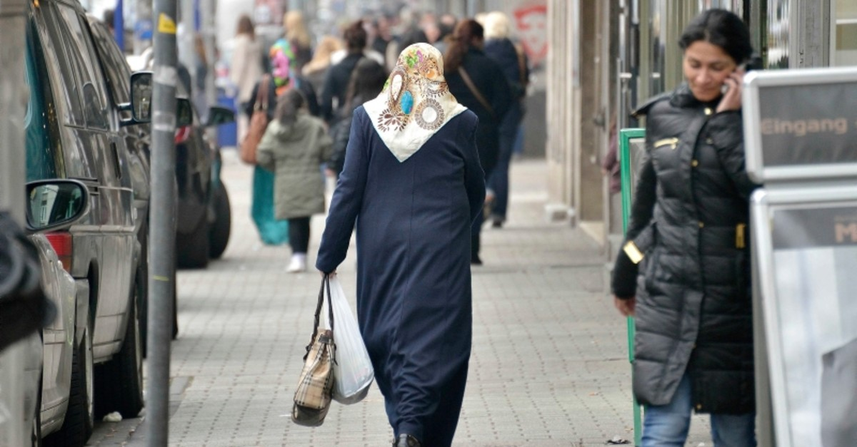 In this March 7, 2013  file photo, a Turkish-background woman walks the shopping streets in Dusiburg-Marxloh, western Germany. (AP Photo)