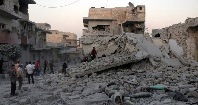 This photo released Wednesday, Aug. 28, 2019, shows people searching for victims under the rubble of destroyed buildings that was hit by airstrikes in the northern town of Maaret al-Numan, in Idlib province, Syria. White Helmets via AP