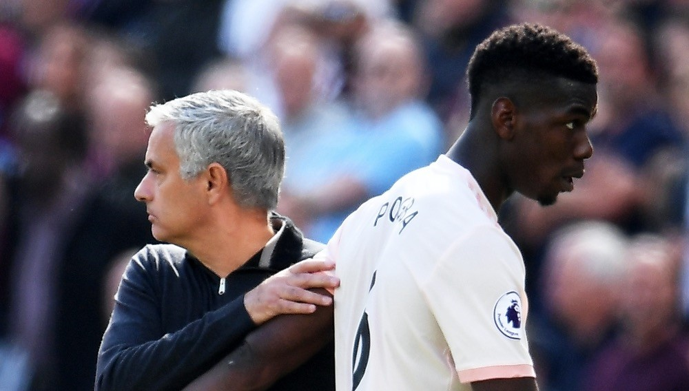 Jose Mourinho (L) and Paul Pogba react during the  English Premier League match between West Ham United and Manchester United in Stratford, east London, Sept. 29.