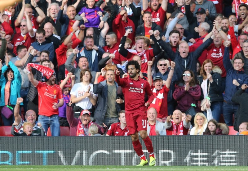 Salah celebrates scoring against Brighton Hove Albion's during the Premier League soccer match between Liverpool and Brighton Hove Albion at the Anfield Stadium in Britain, 25 August  2018. (EPA Photo)
