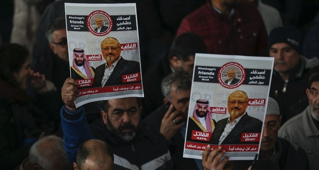 People hold posters as they attend funeral prayers in absentia for Saudi writer Jamal Khashoggi who was killed last month in the Saudi Consulate in Istanbul, Nov. 16.