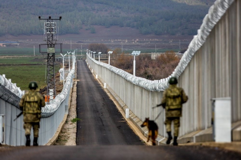 The ,Turkish Wall,, which was built on the Syrian border due to security reasons, is being patrolled by troops along the 900-kilometer (559-mile) long corridor.